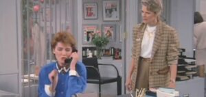 Murphy Brown with one of her rotating cast of secretaries